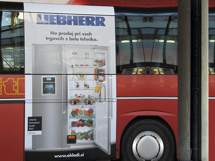Advertising on buses in Slovenia | Sms Marketing d.o.o. | Advertisement on the left side of the bus - Liebherr