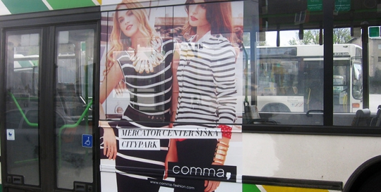Advertising on buses in Slovenia | Sms Marketing d.o.o. | Advertisement on the left side of the bus - Comma